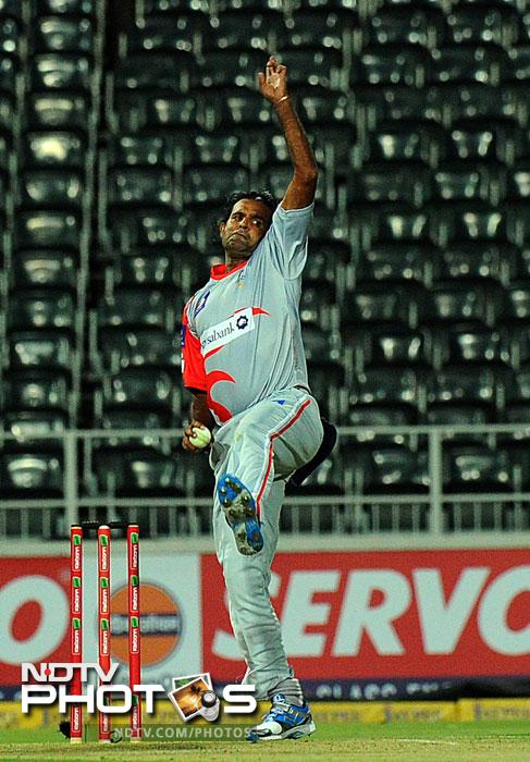Faisal Naved throws the ball during the qualifying stage of the Champions League T20 against the Auckland Aces at the Wanderers Stadium in Johannesburg. (AFP Photo)