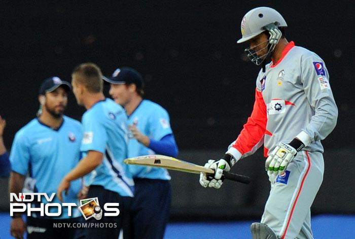 Shakeel Ansar walks back to the pavilion after been caught out for one run during the qualifying stage of the Champions League T20 at the Wanderers Stadium in Johannesburg. (AFP Photo)