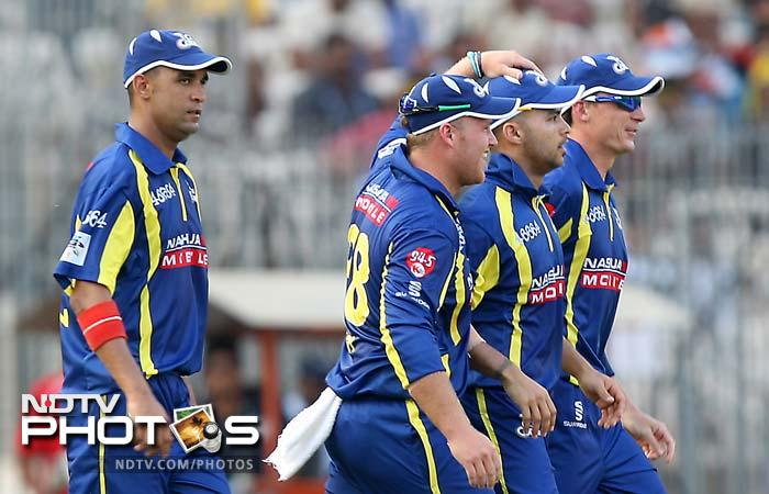 Cape Cobras' players walk off the field after restricting New South Wales to 136 for 3 in the allotted overs.