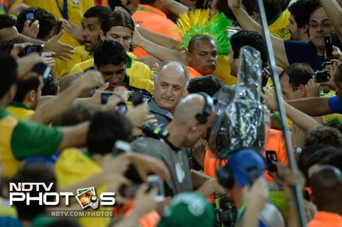 Fans go all over Luiz Felipe Scolari and the Brazil team as they walk out for the presentation.
