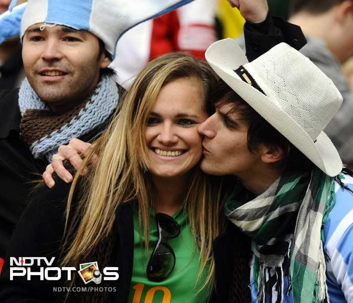 Speaking of passion, cross-border love too seems to be in full flow as an Argentina fan kisses a Brazilian spectator without much resistance from either her or people around.