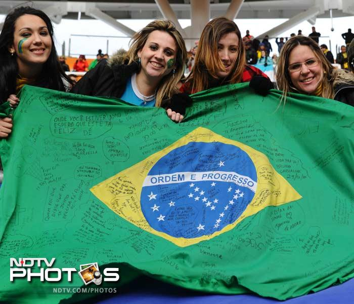 Brazilian fans cheer with their national flag at the Ciudad de La Plata stadium in La Plata, 59 Km south of Buenos Aires.
