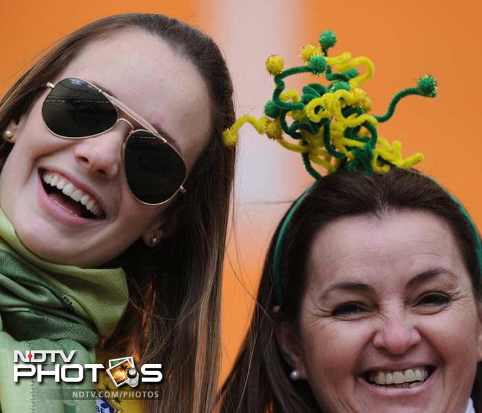 Yellow and green are the colours of the day when Brazil take to the field. Whether hair-bands like in this picture or tattoos, no expense is spared to cheer the team while keeping the style quotient in check.