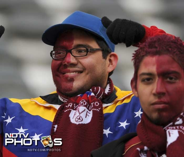 It's not just the Brazilians who are known for their ferocious style of showing support. Venezuelan fans such as these are also equally passionate about the sport, their team and the players.