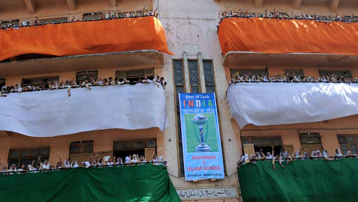 Students from Anjuman-E-Islam school pose with tri-colours for the India-Pakistan clash.(Image courtesy: AFP)
