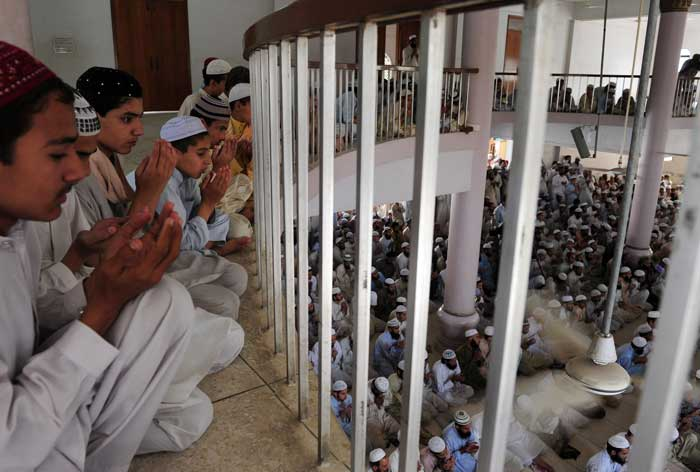 Pakistani seminary students hold a mass prayer service for victory on the other side of the border.(Image courtesy: AFP)