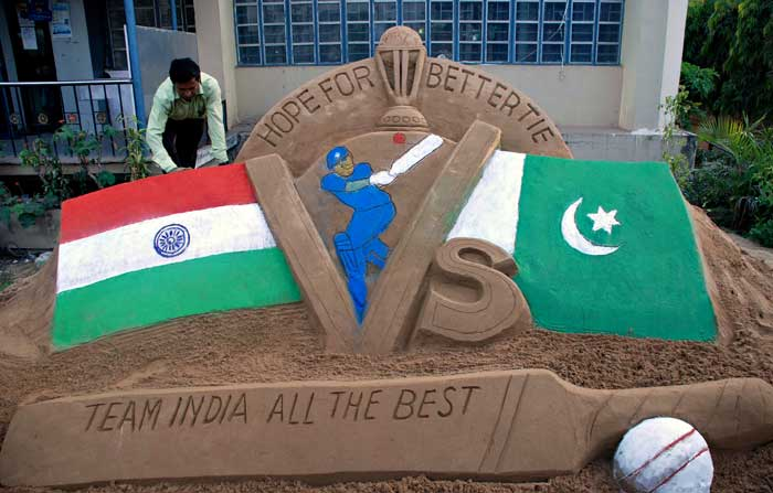 Artist Subala Moharana proves a point by building a sand sculpture and wishes India all the best!!(Image courtesy: AFP)