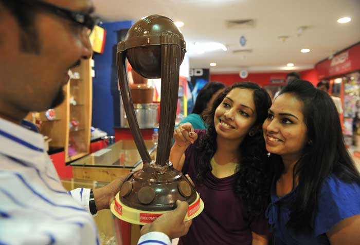 Chocolatier Konda Karthik shows off a chocolate World Cup trophy as young girls look on excitedly. Yummy!!(Image courtesy: AFP)