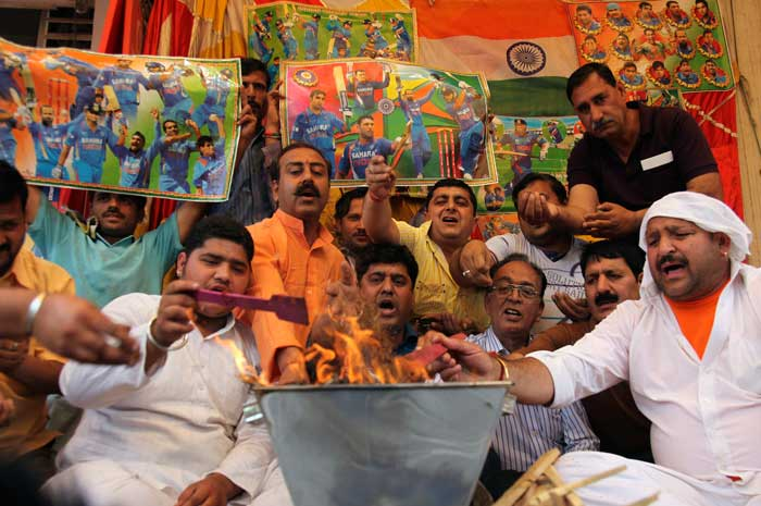 Frenzied fans perform rituals for the victory of the Indian cricket team.