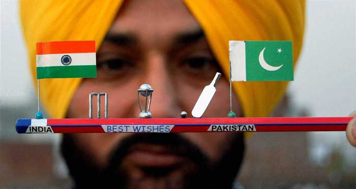 Artist H S Gill from Amritsar shows off miniature art with a miniature trophy and flags of India and Pakistan on a pencil. That's called creativity.