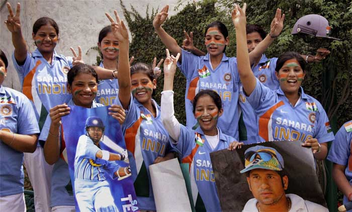 Young cricket fans in Jalandhar wearing Indian team's jersey, show their support.