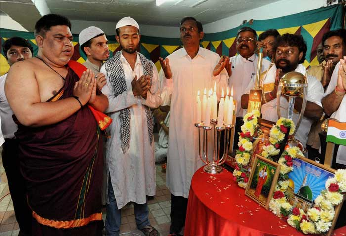 Priests of different religions offer prayers for team India.
