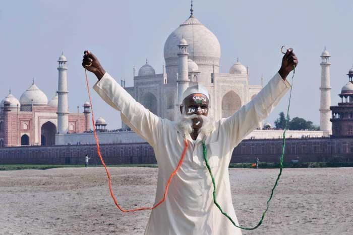 In the backdrop of the glorious Taj Mahal, a fan paints his 16 ft. long mustache in tricolours.