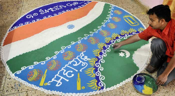 Everyone has their own way, here artist Sanjay Sethi makes a rangoli to show his support.