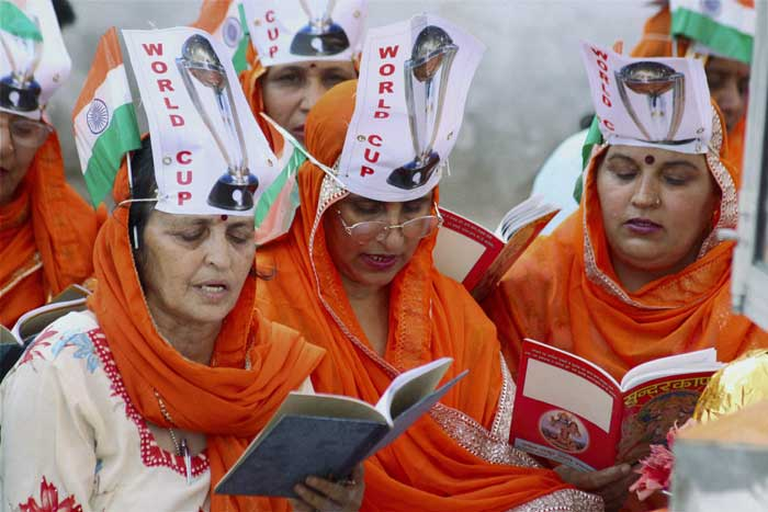 Women show their dedication, pray and chant for Team India's win in Mohali today.