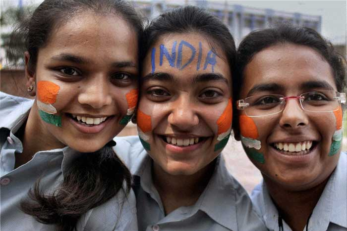 School students from Gurgaon, cheer for Team India with tri-coloured painted faces.