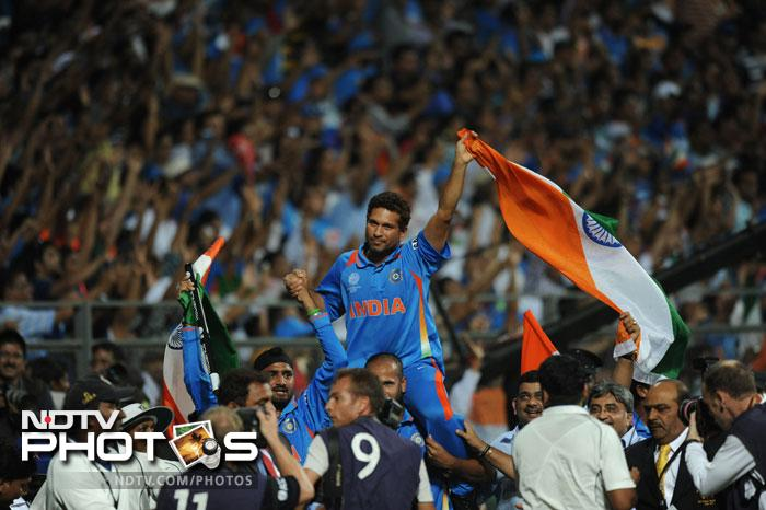 """<b>Lap of honour for Sachin:</b> This was one achievement Sachin Tendulkar yearned for the most in his career and it eluded him for 21 years. And when it happened, his teammates gathered to pay their ultimate tribute to the maestro. Youngsters led by Virat Kohli and Yusuf Pathan carried him around the stadium on their shoulders. Kohli said: """"Tendulkar has carried the burden of the nation for 21 years. It was time we carried him."""" It indeed was a fitting gesture."""