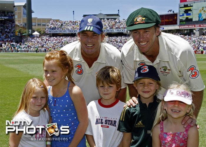 Shane Warne (rear L) with his children Summer (L), Brooke (2nd L) and Jackson (C) and McGrath (rear R) with his son James (2nd R) and daughter Holly (R).