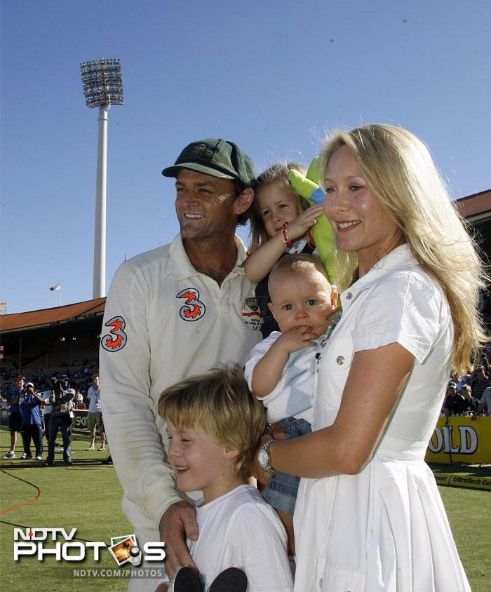Gilchrist (L) poses with his wife Mel (R), sons Harrison (bottom) and Archie (C) and daughter Annie (C,top) after retiring from Test cricket in 2008.