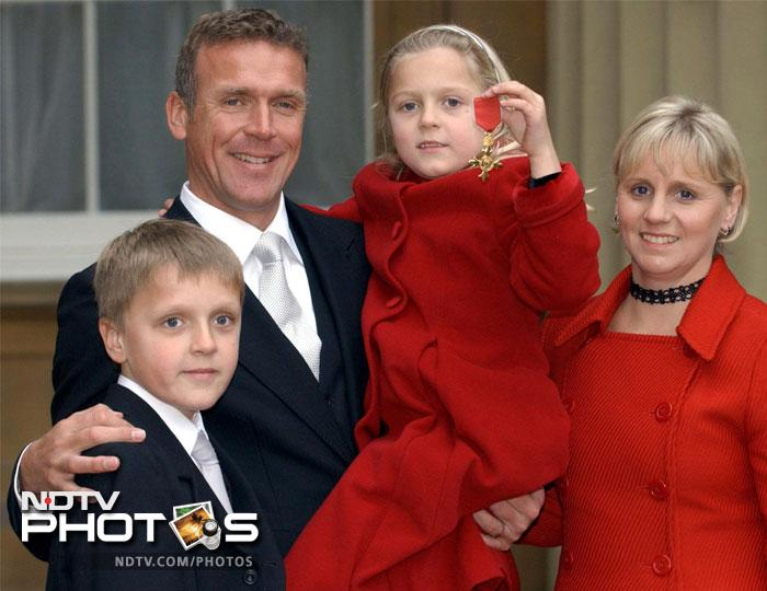 Surrey cricketer Alec Stewart stands with his wife Lynn and children Andrew, 10, and Emily, 7, in this photograph taken in 2003.