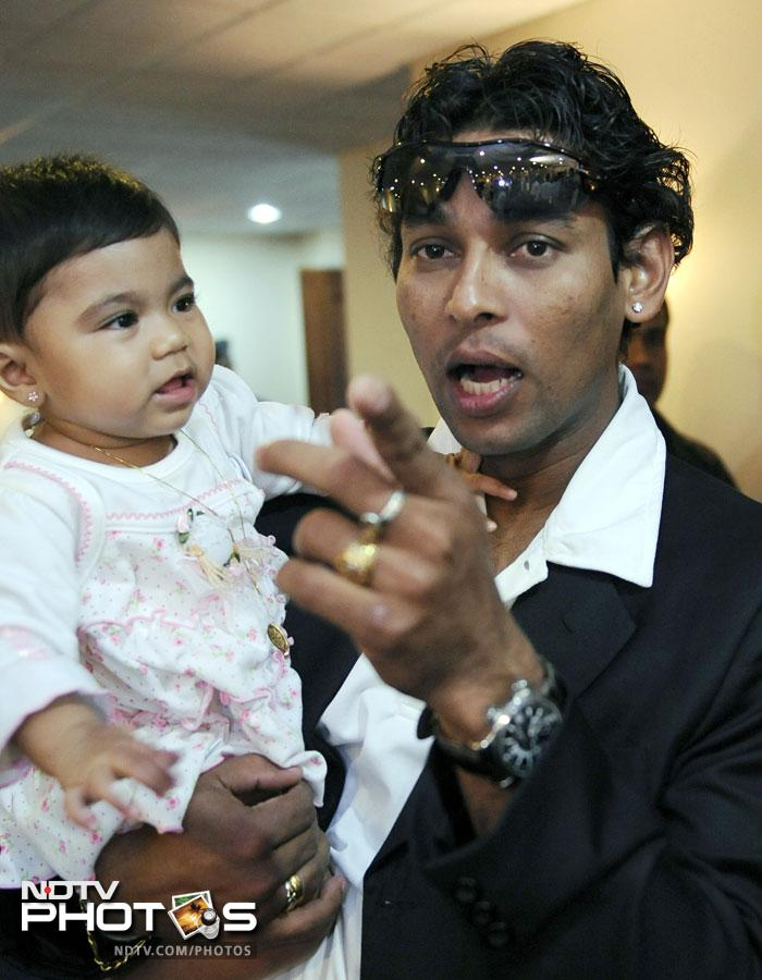 Sri Lankan cricketer Thillakeratne Dilshan with his son in this picture clicked in 2009.
