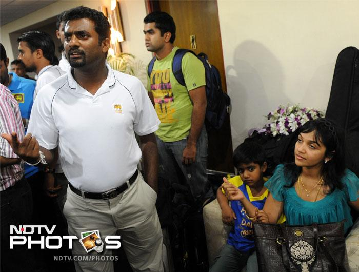 Muttiah Muralitharan (L) with his son Naren (2R) and wife Madhi Malar in April 2011.