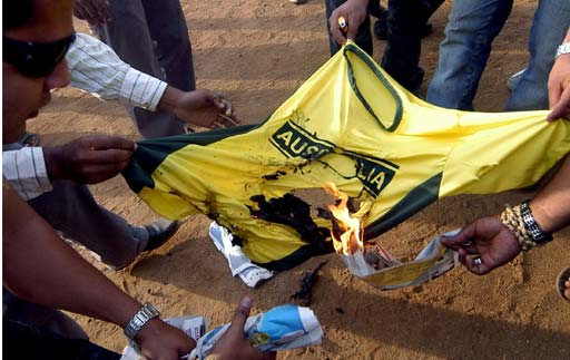 Indian cricket fans set fire to an Australian cricket jersey during a protest in Mumbai, against the outcome of the second Test match between India and Australia in Sydney.