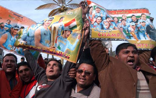 Indian cricket supporters wave posters featuring images of Indian cricketers as they stage a protest in Amritsar.