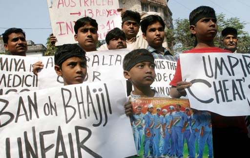 Indian activists display posters during a protest in Kolkata.