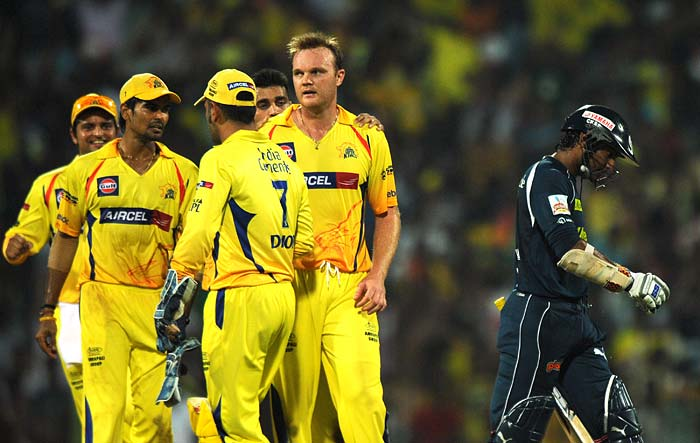 Chennai Super Kings bowler Doug Bollinger(2nd R) celebrates taking the wicket of Deccan Chargers captain Kumar Sangakara with his teammates during the IPL Twenty20 match at the M.A. Chidambaram Stadium in Chennai. (AFP PHOTO)