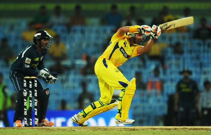 Chennai Super Kings batsman Michael Hussey is watched by Deccan Chargers wicketkeeper Kumar Sangakkara as he plays a shot during the IPL Twenty20 match at the M.A. Chidambaram Stadium in Chennai. (AFP PHOTO)