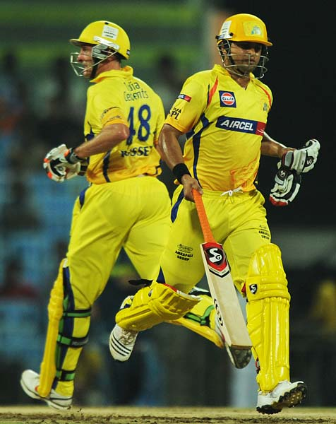 Chennai Super Kings batsman Suresh Raina (R) and Michael Hussey run between the wickets during the IPL Twenty20 match against Deccan Chargers at the M.A. Chidambaram Stadium in Chennai. (AFP PHOTO)