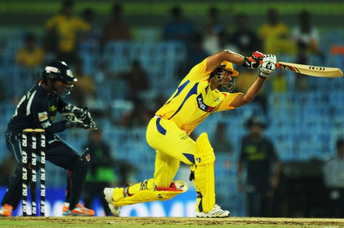Chennai Super King batsman Suresh Raina is watched by Deccan Chargers wicketkeeper Kumar Sangakkara as he plays a shot during the IPL Twenty20 match at the M.A. Chidambaram Stadium in Chennai. (AFP PHOTO)