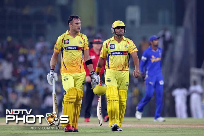 Chennai Super Kings batsmen Francois Du Plessis (L) walks with Suresh Raina (R) during the IPL Twenty20 cricket match against Rajasthan Royals at the M.A.Chidambaram Stadium in Chennai. (AFP PHOTO/Seshadri SUKUMAR)