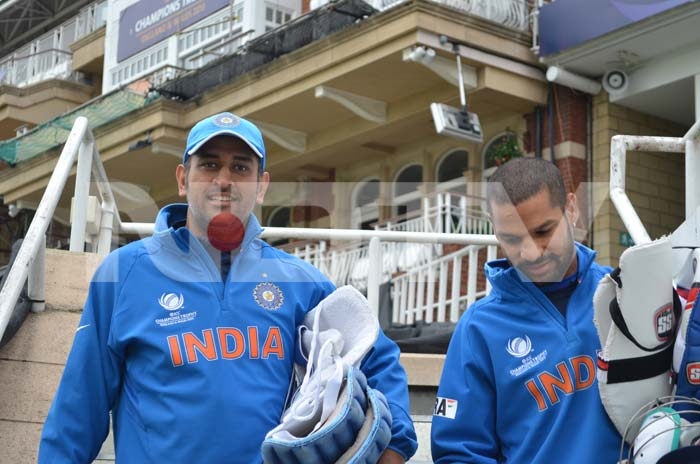 Dhoni and Dhawan on the way for a session at the nets.