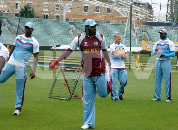 Chris Gayle has a stretch in the nets as he gears up for the clash against India.