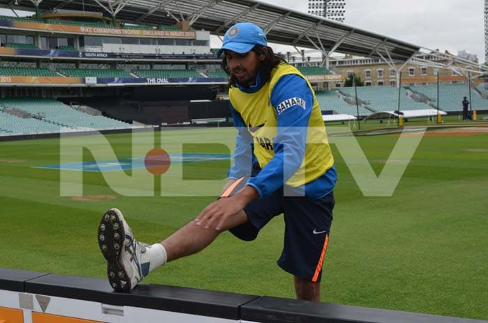 Ishant Sharma giving his limbs a loosening ahead of a net session.