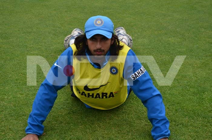 Ishant does a stretch during training.