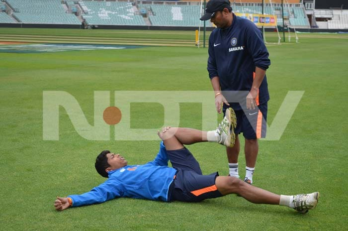 Umesh does a stretch to relax the muscles before bowling.