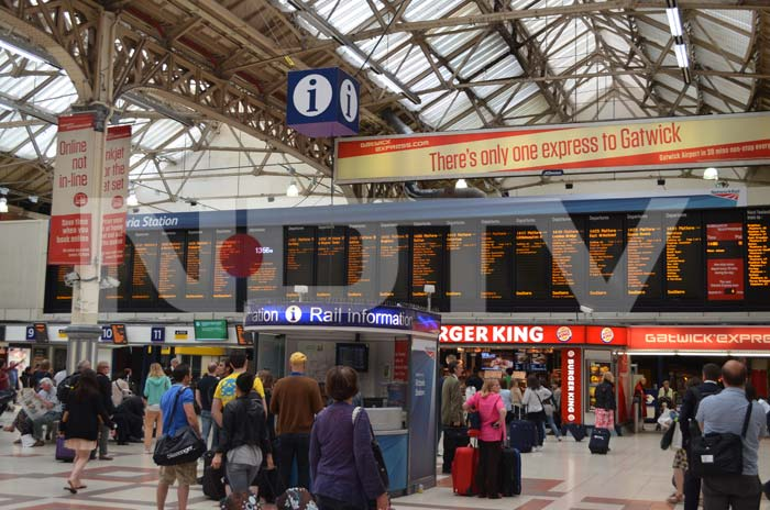 The Victoria station at London is full of activity.