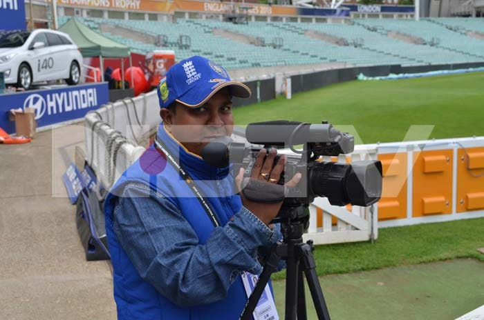 An Indian TV journalist captures the action on his camera on a cold day.