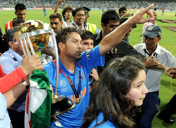 The man of the moment. Sachin expressed his gratitude to his home-crowd.<br><br>It wasn't just the 32,00 odd people present at the Wankhade stadium who prayed for Team India to win the cup for Sachin but millions of his fans across the globe pitched in, in their own unique manner.<br><br>Also seen in this picture, Sachin's daughter Sarah and the 'coveted cup'.