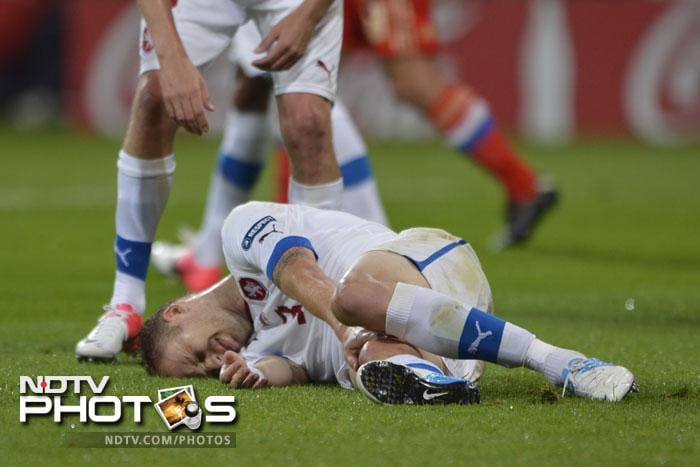 The Czechs tried hard but it was more of agony than anything else for them. Czech defender Michal Kadlec lies on the pitch after being fouled during the Euro 2012 football match. (AFP PHOTO / FABRICE COFFRINI)