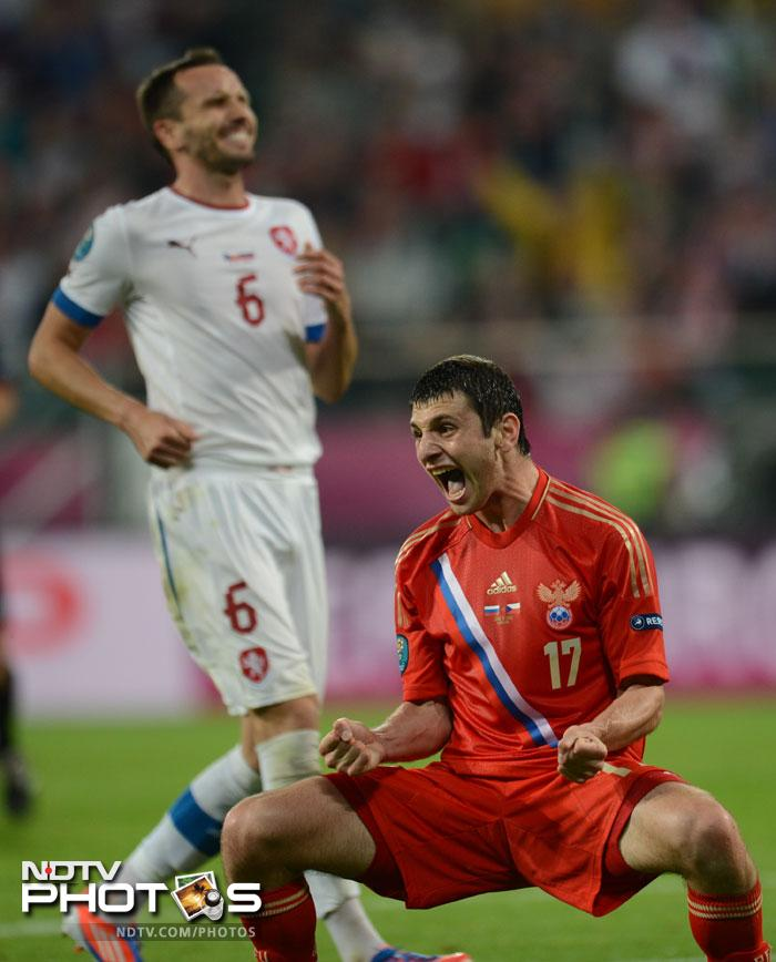 It was Dzagoev again, who scored to restore a 2 goal cushion for Russia. The Russian midfielder (R) celebrates after scoring the third goal as Czech defender Tomas Sivok reacts in disappointment. (AFP PHOTO / DANIEL MIHAILESCU)