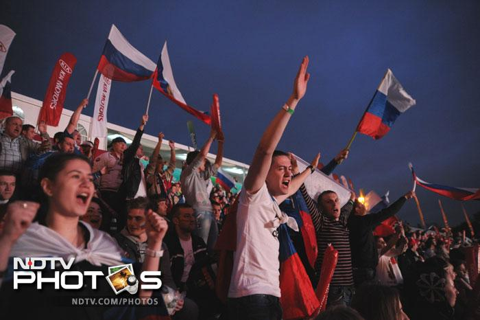 It was a moment to celebrate for the Muscovites back home as their team (Russia) looked in stupendous form, romping home to a massive victory in their opening group encounter against Czech Republic. (AFP PHOTO / ANDREY SMIRNOV)