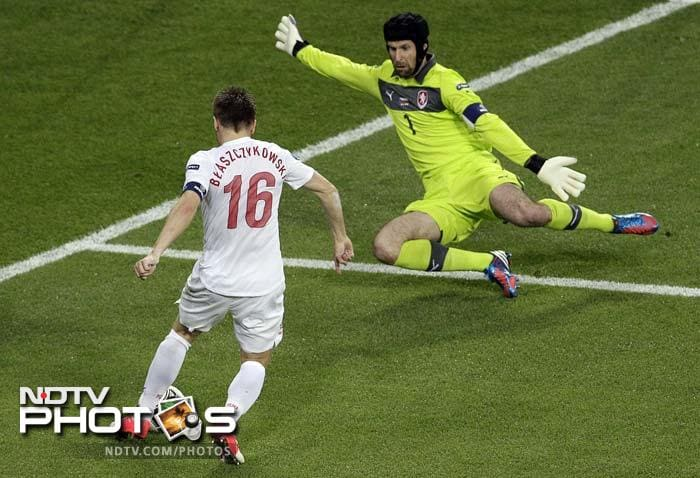 Czech goalkeeper Petr Cech prepares to save a shot by Poland's Jakub Blaszczykowski during the Euro 2012 soccer championship match in Wroclaw.