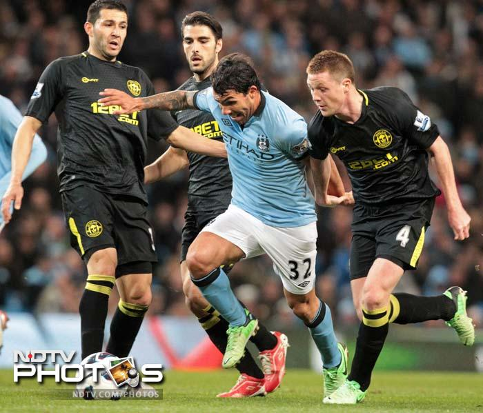 Manchester City made it five wins from their last six matches when Argentina forward Carlos Tevez lashed into the top corner in the 83rd minute for a 1-0 win over Wigan.