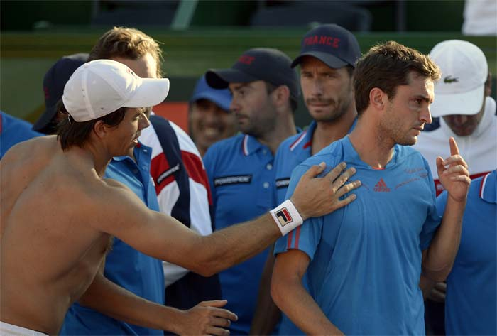 Simon(right) seemed in no mood to accept words of ease and comfort from Berlocq after their Davis Cup World Group quarterfinal single match.