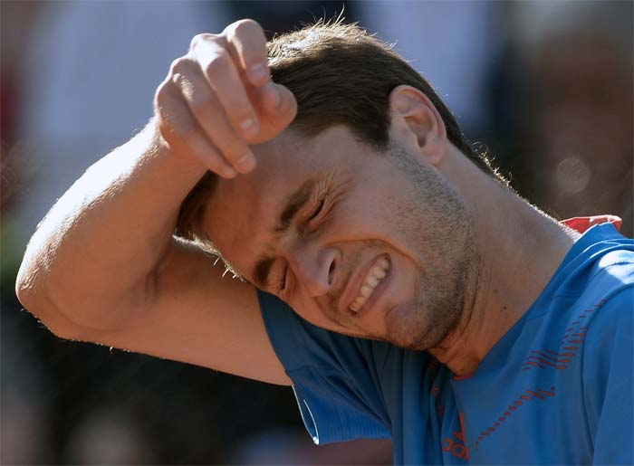France's Gilles Simon found it hard to accept the disappointment.