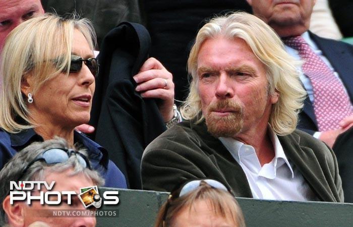 British businessman Richard Branson (R) and tennis legend Martina Navratilova attended the women's semi final between Azarenka and Kvitova. (AFP Photo)